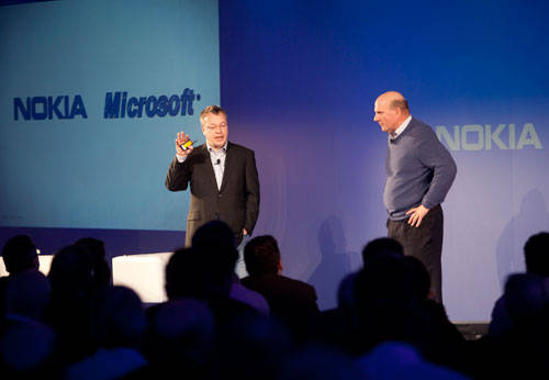 Stephen Elop from Nokia and Steve Ballmer from Microsoft on stage in London